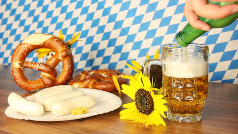 pouring beer into the glass in front of the bavarian flag Footage