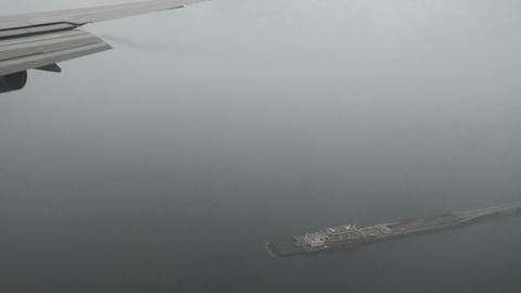 Plane in the rain fly over the bay Footage