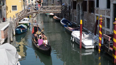 Gondolier steering the boat and telling the tourists about Venice Footage