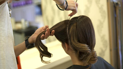 Hairdresser is Making The Hairstyle For a Woman Footage
