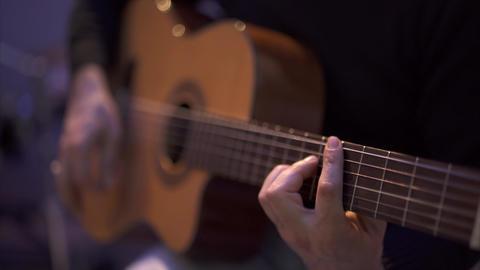 Man Playing Guitar - Close Up Footage