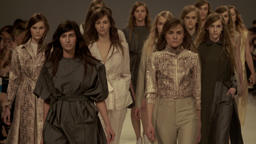 Many models walk down the runway at fashion show Footage