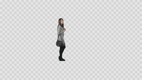 Sexy slender girl in casual wear is walking and looking at something Live Action
