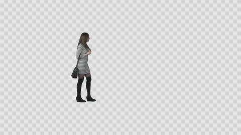 Slender girl in striped mini dress and long socks is strolling, looking around Footage