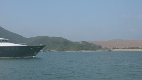 boat floats on the background of volcanic Sai Kung Islands Footage