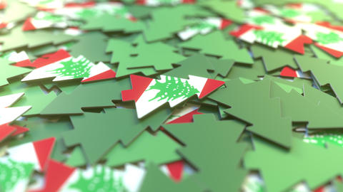 Details of flag of Lebanon on the paper Christmas trees. Winter holidays related Live Action