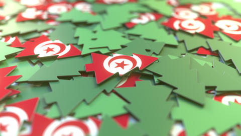 Details of flag of Tunisia on the paper Christmas trees. Winter holidays related Live Action