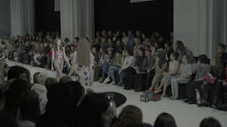 A lot of the audience watching the fashion show Footage