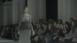 Young girl model shows a dress during the fashion show Footage