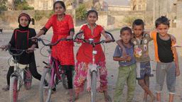 Girls on bicycles and boys at Mahabat Maqbara Mausoleum,Junagadh,India Footage
