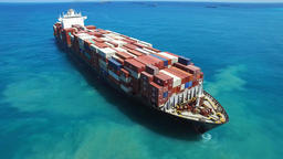 Mega container ship at sea - Top down aerial view Footage