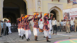 Folk dancers with stick in procession,Jaipur,Gangaur,India Footage