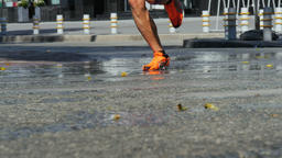 male runners ran through puddles of water splashing under running shoes Footage