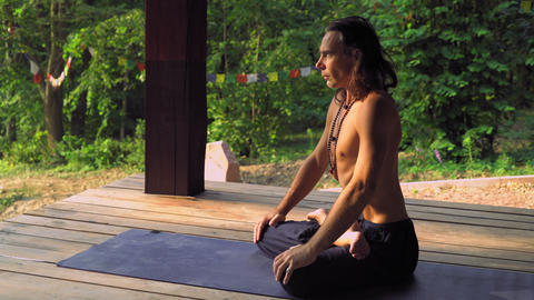A man who practices yoga draws heavily stomach Footage