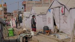 Woman and chicken in refugee tent camp,Bhaktapur,Nepal Footage