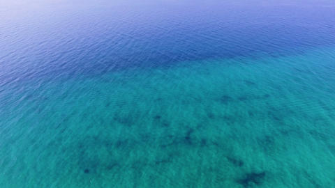 Aerial view of beautiful turquoise and blue sea. Drone footage of blue and clear open sea Live Action