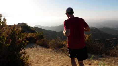 A man going for his moring workout in the hills above Hallywood Live Action