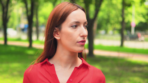 attractive woman looks camera outdoors Footage