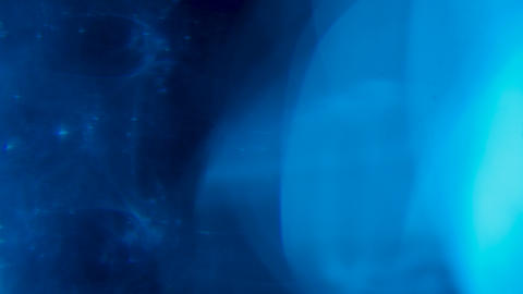 Blue light effect with glow flares over black background Live Action