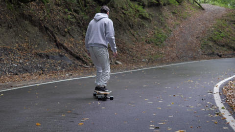 Skateboarder riding carving turns on skateboard on... 動画素材, ムービー映像素材