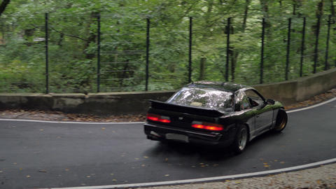 Black car extreme speed turn in drift on narrow countryside road. Japanese jdm car driving with slip ビデオ