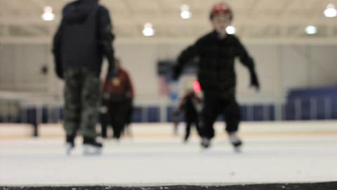 Kids Skating Off Ice Rink Footage