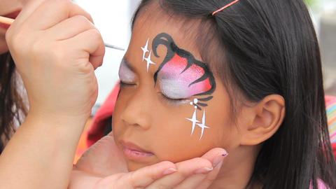 Little Asian Girl Happy With Her Face Paint Stock Video Footage
