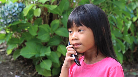 Little Asian Girl Talking On Cell Phone Stock Video Footage