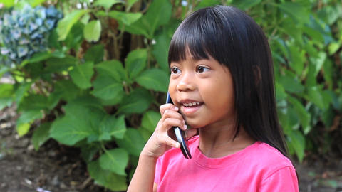 Little Asian Girl Talking On Cell Phone Footage