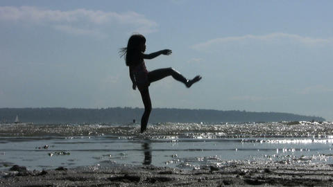 Little Girl Doing Twirls At The Beach Live Action