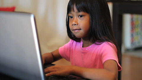 Little Girl Playing Games On A Lap Top Footage