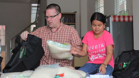 Missionary Packs Up Rice In A Care Package Stock Video Footage