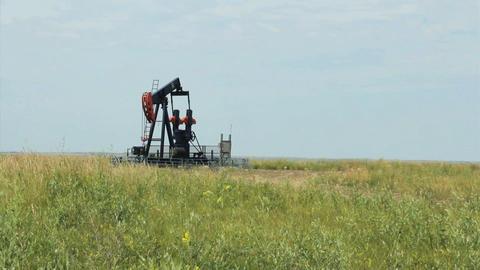 Oil Derrick On Canadian Farm Stock Video Footage