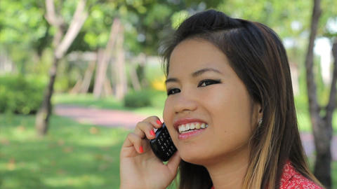 Pretty Asian Girl Having A Happy Cell Phone Call Stock Video Footage