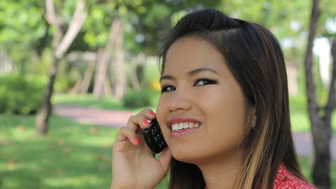 Pretty Asian Girl Having A Happy Cell Phone Call Footage