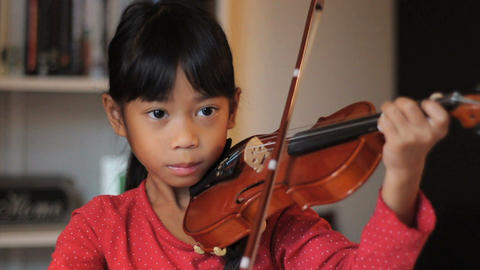 Proud Girl Finishing Practising Her Violin Stock Video Footage
