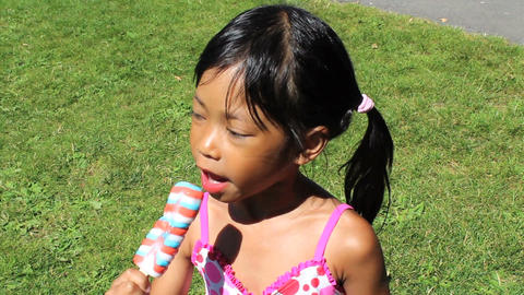 Little Girl Enjoying A Popsicle Stock Video Footage