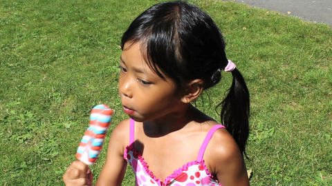Little Girl Enjoying A Popsicle stock footage