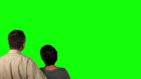 Happy couple over green screen Footage