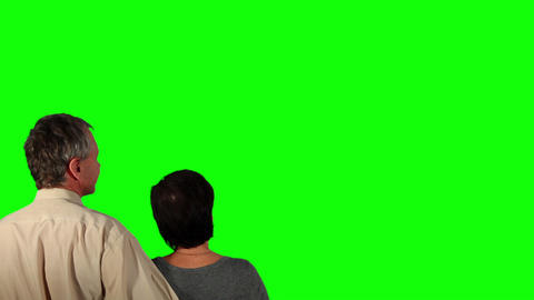 Happy couple over green screen Stock Video Footage