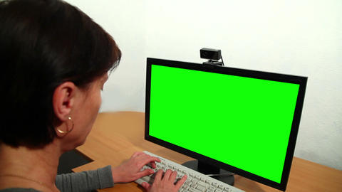 Woman uses a computer. Over his shoulder Stock Video Footage