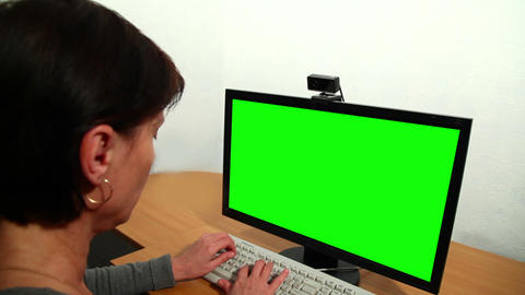 Woman uses a computer. Over his shoulder Footage