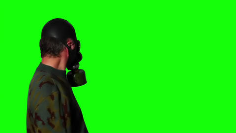 Man in gas mask on a green screen Live Action
