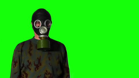 Man in gas mask on a green screen Stock Video Footage