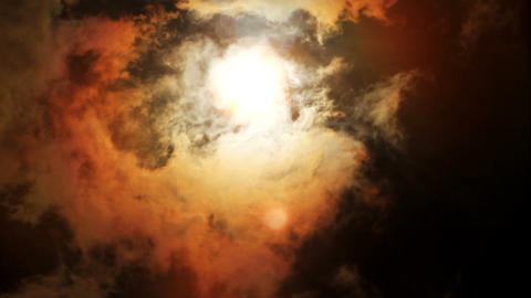 Sun behind dark cloud Stock Video Footage