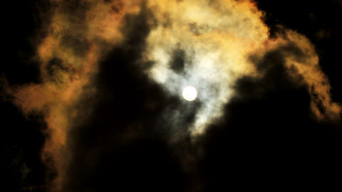 Sun behind dark cloud Stock Video Footage