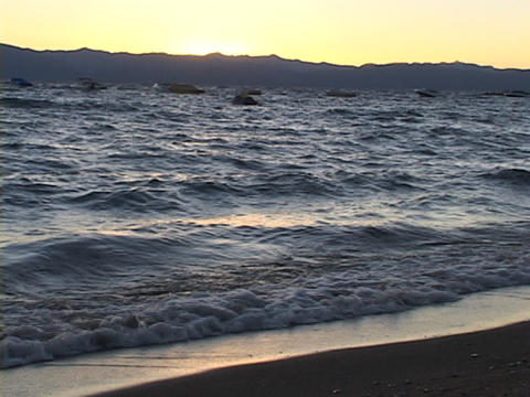 Waves lap the shore at Lake Tahoe Stock Video Footage