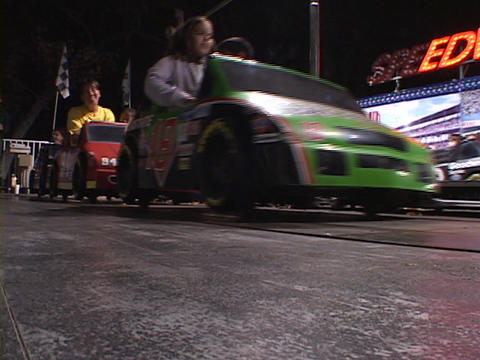 Children enjoy a carnival speedway ride Stock Video Footage