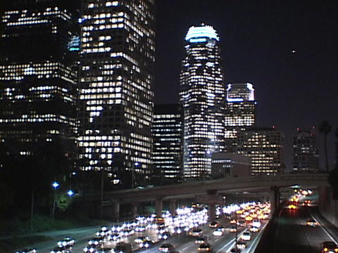 Heavy traffic drives through downtown Los Angeles at night Stock Video Footage