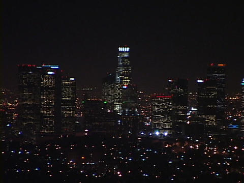 Downtown Los Angeles office buildings lights shine bright at night Footage
